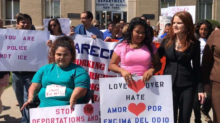 Dozens of immigrant advocates rallied on Wednesday, Aug. 30,