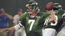 Jets quarterback Boomer Esiason unloads a pass against