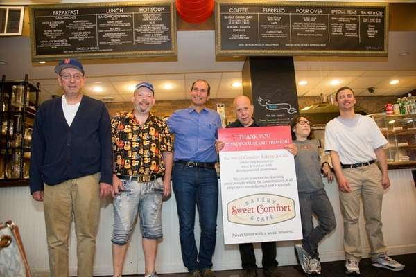 Cafe employees Paul Marcellino, from left, Adam Robbins,