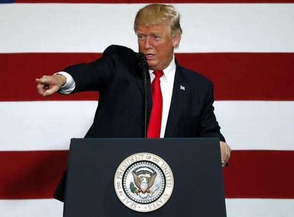 President Donald Trump gestures while speaking about tax