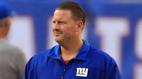 Giants head coach Ben McAdoo watches the team