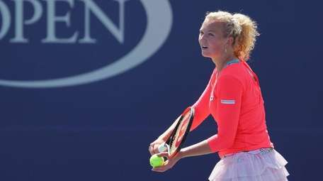 Katerina Siniakova of Czech Republic serves to Elina