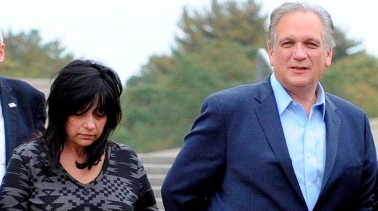 Linda Mangano and Edward Mangano, outside federal court