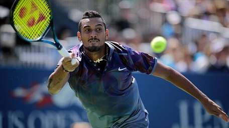 Nick Kyrgios makes a running forehand return against