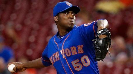 Mets starting pitcher Rafael Montero throws in the