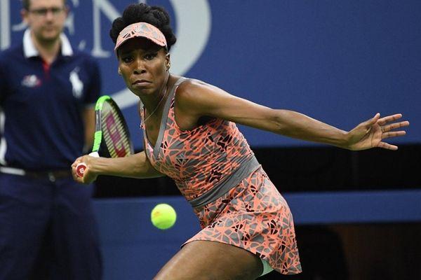 Venus Williams looks to return a shot to