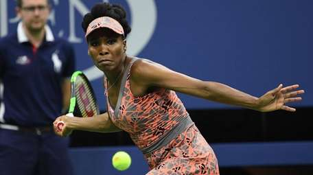 Venus Williams looks to return a shot to