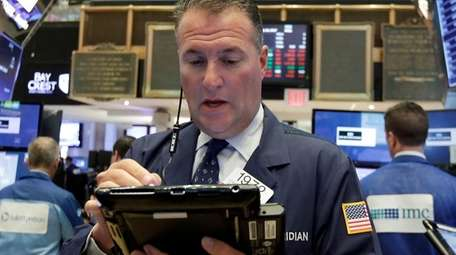 Trader Jonathan Corpina works at the NYSE, Aug.