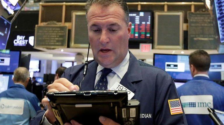 Trader Jonathan Corpina works at the NYSE, Aug.