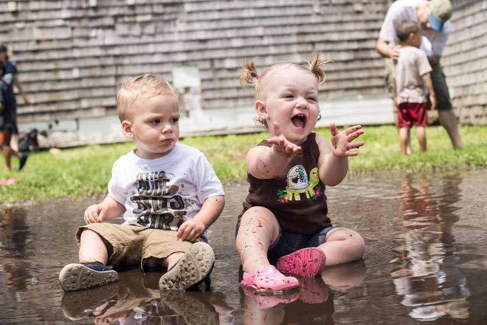 Paige and her cousin Thomas getting dirty and