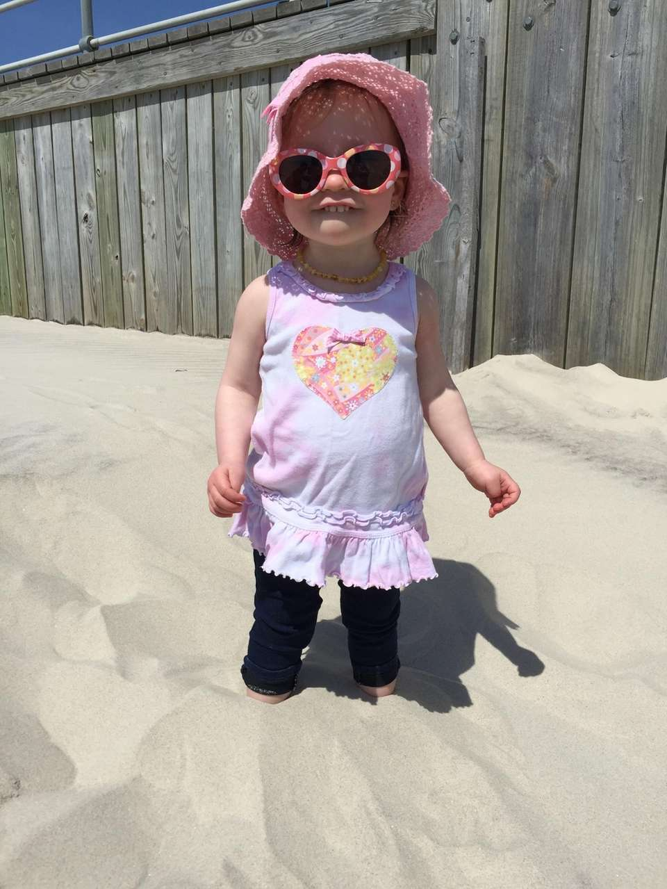 Amelie experiences putting her toes in the sand