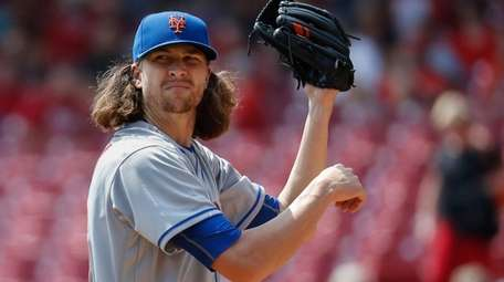 Mets pitcher Jacob deGrom reacts in the first