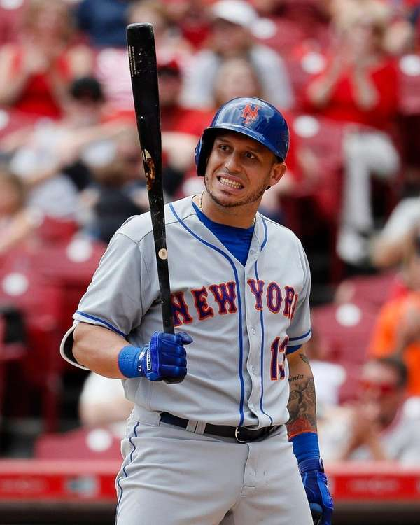 Mets' Asdrubal Cabrera reacts to striking out against
