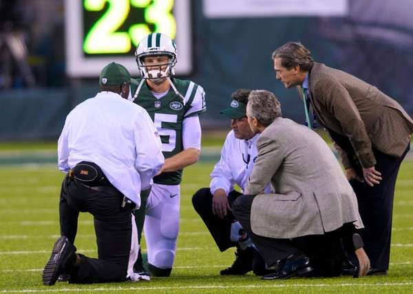 Jets quarterback Josh McCown is attended to after taking