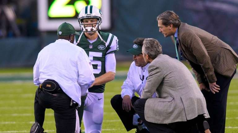 Jets quarterback Josh McCownis attended to after taking