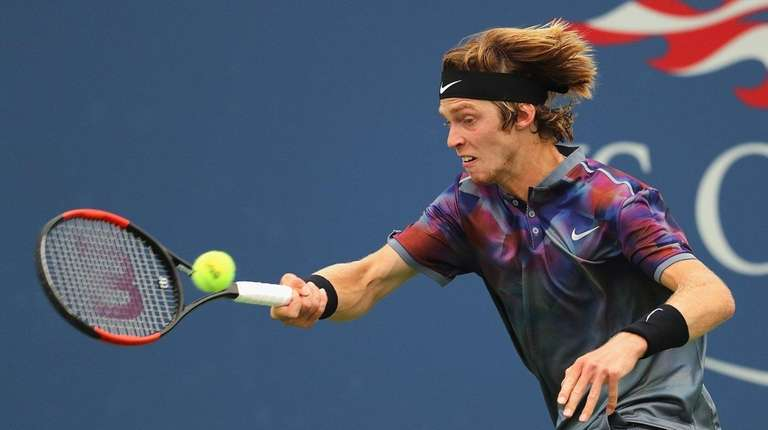 Andrey Rublev of Russia returns a shot against
