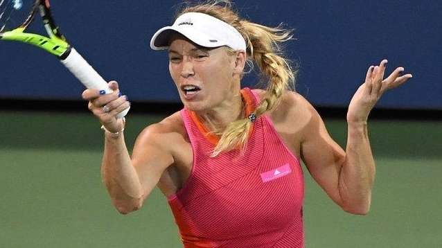 Caroline Wozniacki returns a shot to Ekaterina Makarova