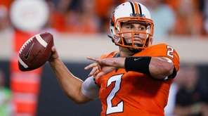 Oklahoma State quarterback Mason Rudolph passes during the