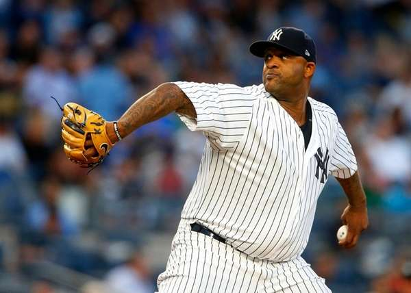 CC Sabathiaof the Yankees pitches in the first