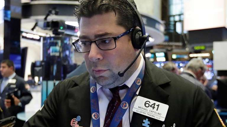 Trader Michael Capolino works at the NYSE, Aug.