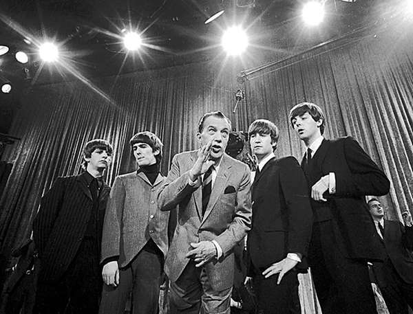 Show host Ed Sullivan, center, with members of
