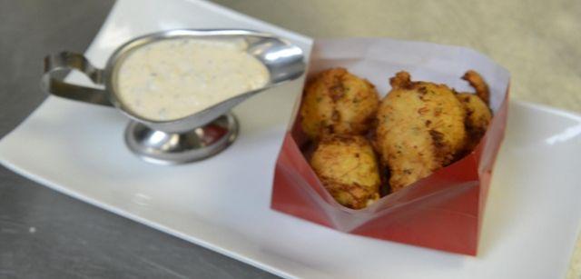 Chef-partner Robert Carmosina fries up his specialty shrimp