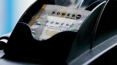 Powerball lottery tickets are dispensed at convenience store