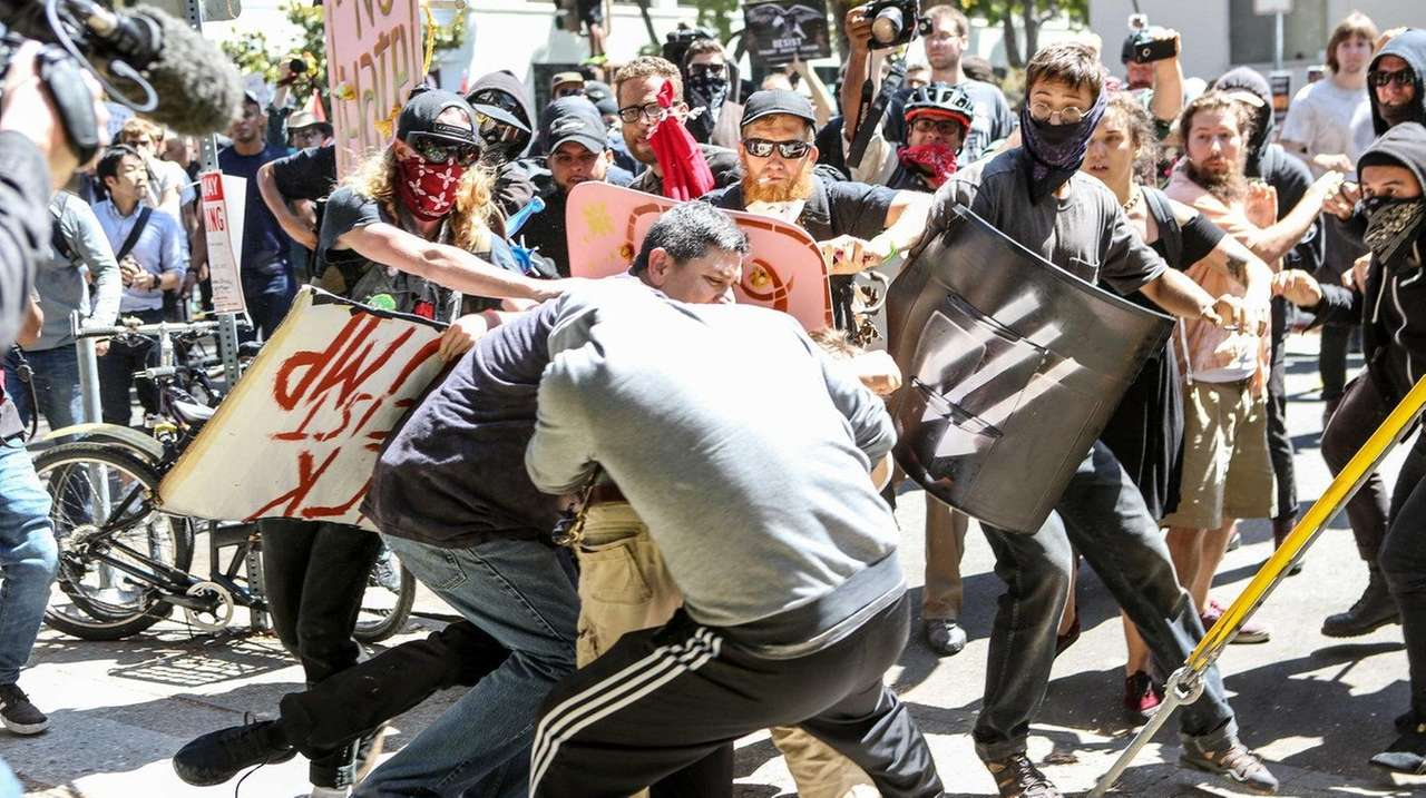 No To Marxism demonstrators and counterprotesters clash on