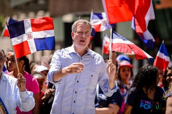Mayor Bill de Blasio marches in the