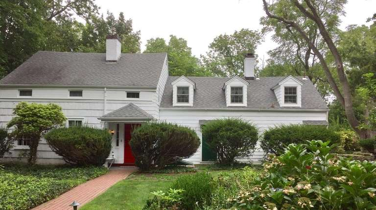 Set on 1.35 acres, this Huntington home is