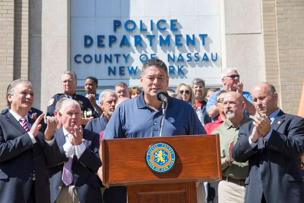 Nassau Police Benevolent Association President James McDermott, center,
