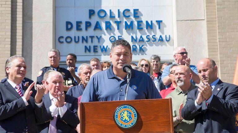 Nassau Police Benevolent Association President James McDermott, center,