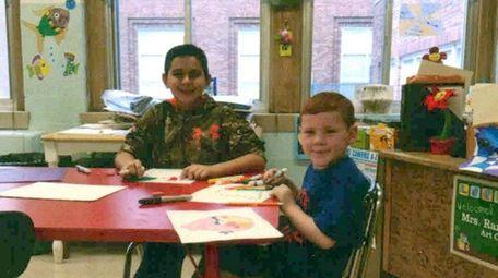 Kidsday reporter Joey Bruno, left, drawing with schoolmate