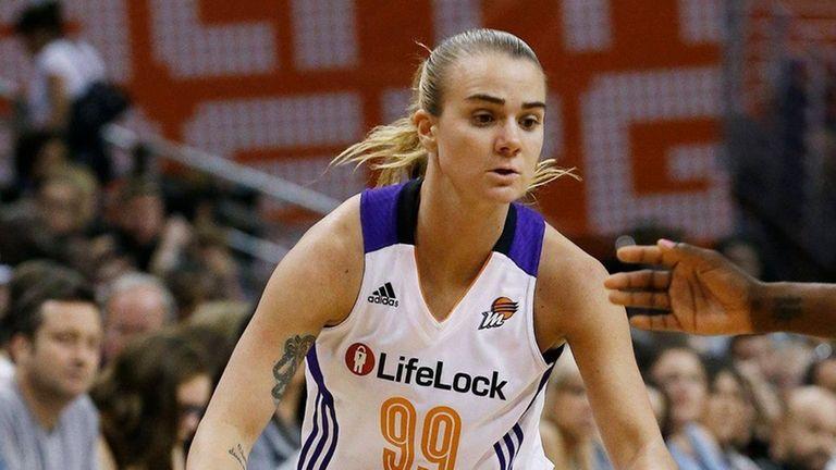 Phoenix Mercury's Samantha Prahalis dribbles against the Los