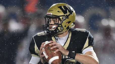 Wantagh quarterback Jake Castellano looks to pass against