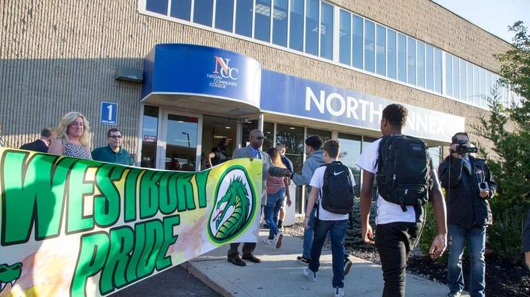 Westbury High School ninth-graders arrive at Nassau Community