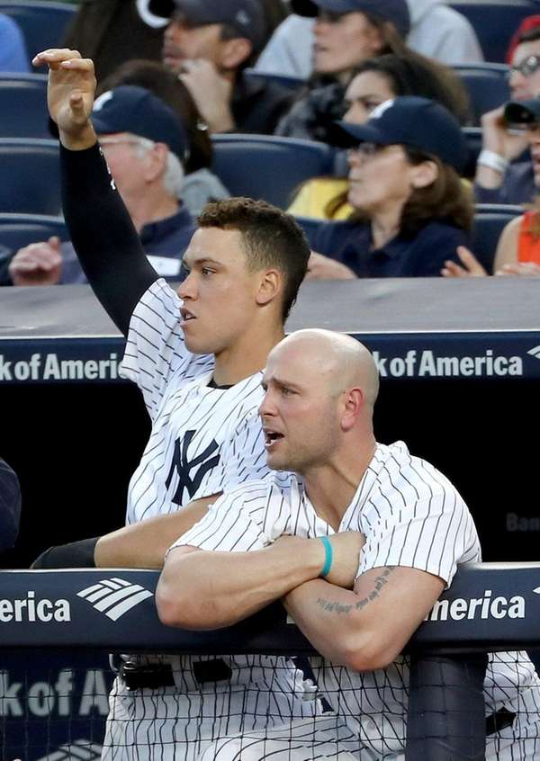 Aaron Judge and Matt Holliday of the Yankees react to teammate