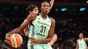 Tina Charles makes a move to the basket