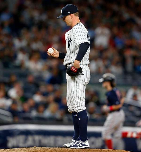Sonny Gray of the Yankees looks on from