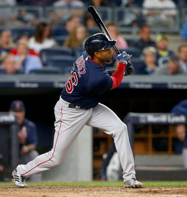Eduardo Nunez of the Red Sox follows through