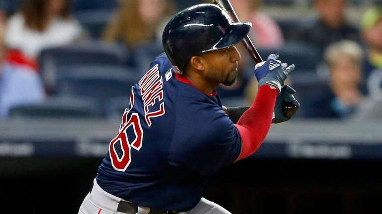 Eduardo Nunez of the Red Sox follows through