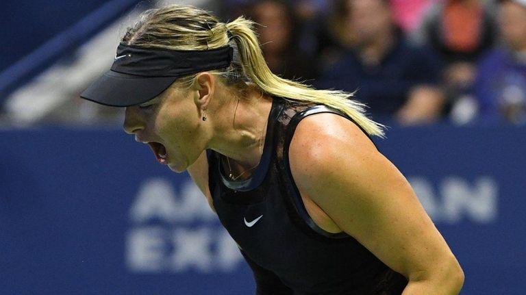 Maria Sharapova reacts against Sofia Kenin at the