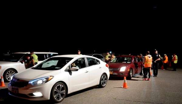 Vehicles pass through a sobriety checkpoint at Route