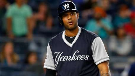 Aaron Hicks of the Yankees strikes out to