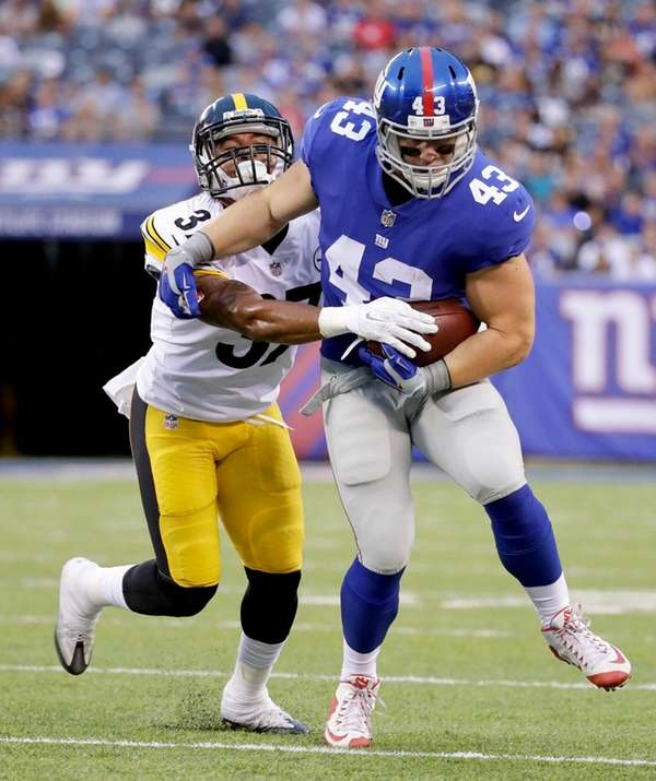 Giants running back Shane Smith tries to break