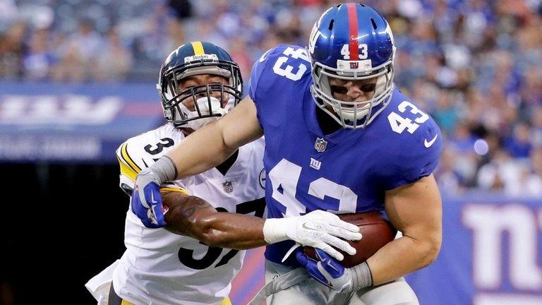 Giants running back Shane Smith tries to break