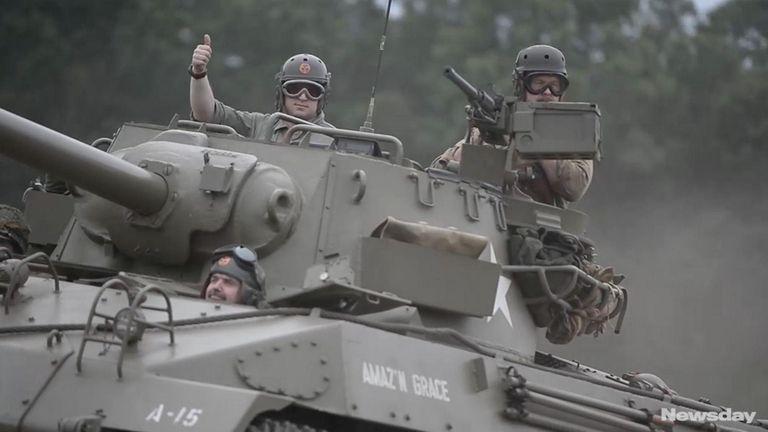 World War II-era tanks rumbled past hundreds of