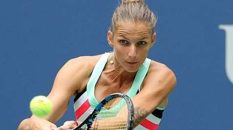 Karolina Pliskova hits the backhand return against Shuai