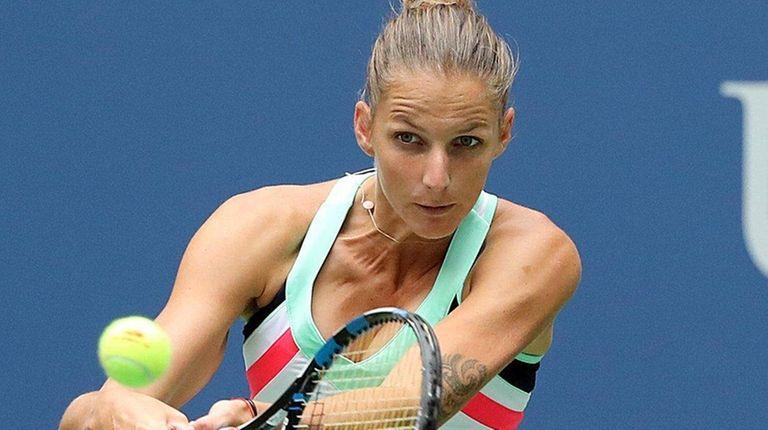 Karolina Pliskova hits the backhand return against Shuai