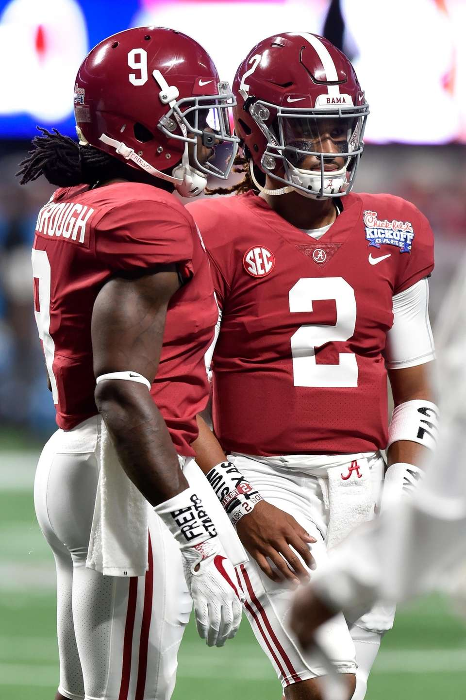 Bo Scarbrough #9 and Jalen Hurts #2 of